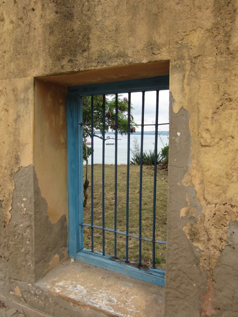 View through the bars of a window on Prison Island
